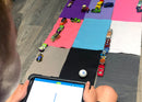 Mini golf course made out of felt and Hot Wheels car and kid programming using draw canvas.