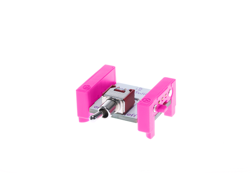 Pink littleBits i2 toggle switch bit side view.
