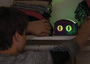 Boy playing with night light invention.