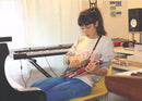 Girl playing with synth music invention.