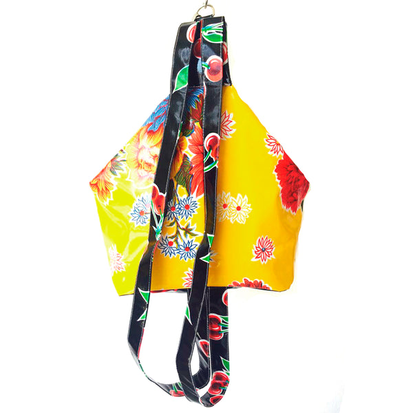 oilcloth backpack in yellow
