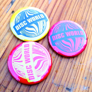 Disc World Badge (Various Colours)