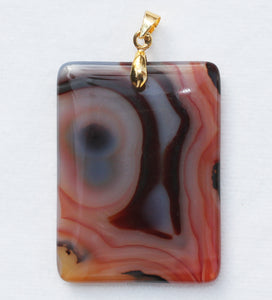 Brazilian Agate Pendant 2 inch oblong in vivid orange with Chevron Banding