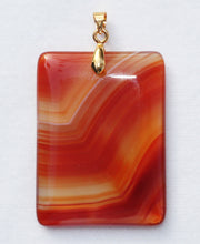 Load image into Gallery viewer, Brazilian Agate Pendant 2 inch oblong in vivid orange with Chevron Banding