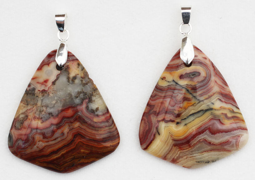 Crazy Lace Agate Pendant in a flame shape.