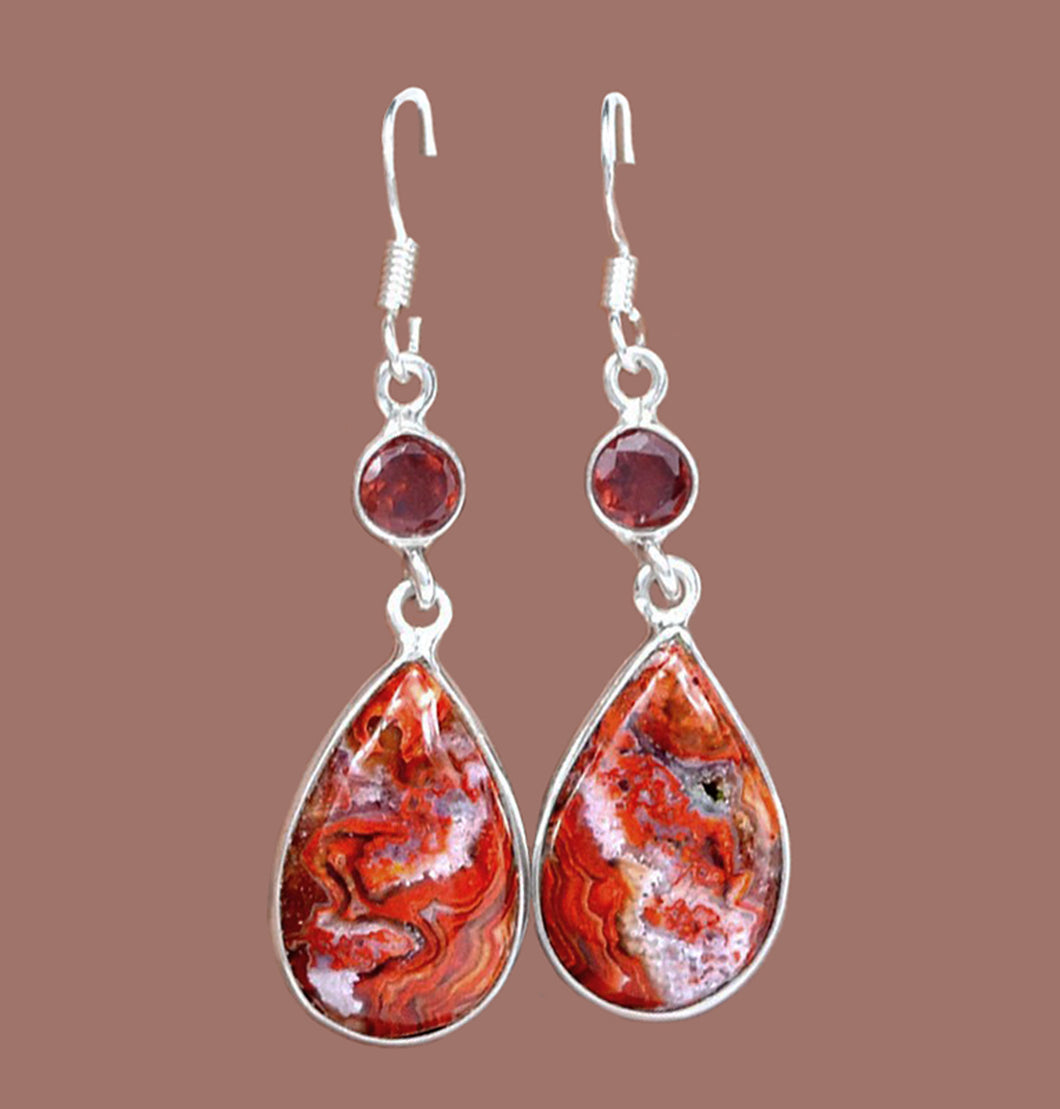 Mexican Laguna Crazy Lace Agate Earrings adorned with faceted round Garnets