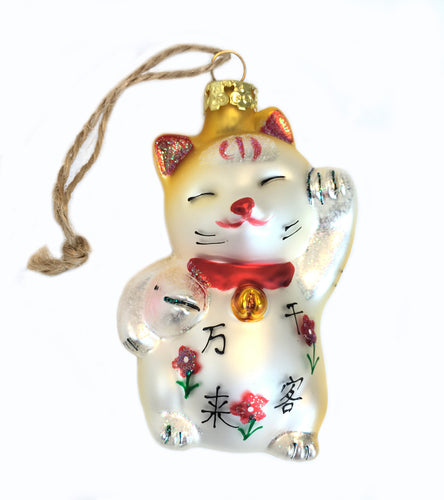 Maneki Neko Cat or Japanese Lucky Cat Ornament in White and Gold that is also a powerful feng shui object for attracting customers and good fortune.