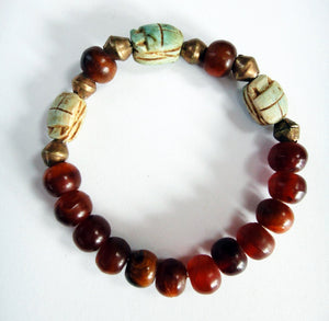 Scarab Bead Stretch Bracelet fits up to a 6.25 inch wrist.