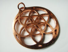 Load image into Gallery viewer, Sacred Geometry Seed of Life Copper Medallion: the Solar Mandala that balances your chakras automatically!