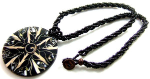 Black Cone Shell, Shiva Shell and Abalone Shell Medallion on black beaded rope.