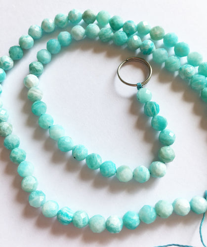 Amazonite Beads 4mm faceted rounds on 15 inch strand.
