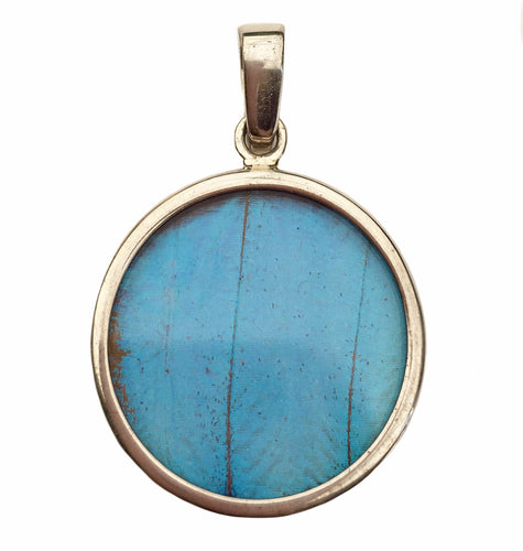 Blue Morpho butterfly wing pendant in a small round shape