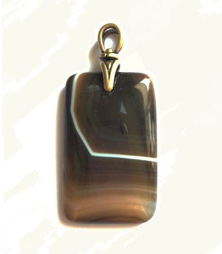 Brown Onyx Pendant with brass bail with dramatic stripe