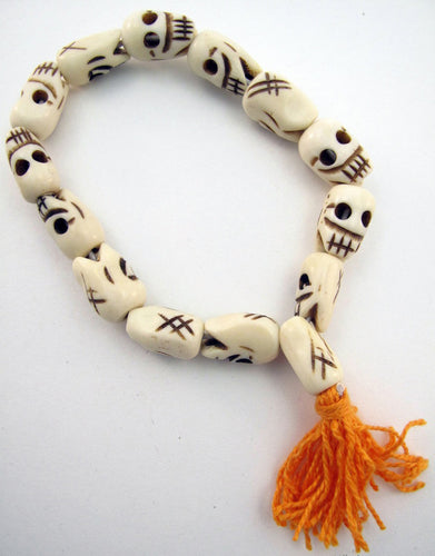 Skull Bracelet of Yak Bone Beads with Orange Cotton Tassel Large