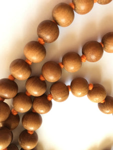Sandalwood Mala 10mm Beads with Light Orange Tassel