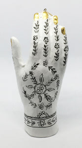Henna Hand in White with Black Mehndi Design and Gold Nails Ornament