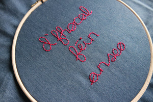 D'fhocal féin anseo. Your text here in Irish. Hand-embroidered on denim tote bag