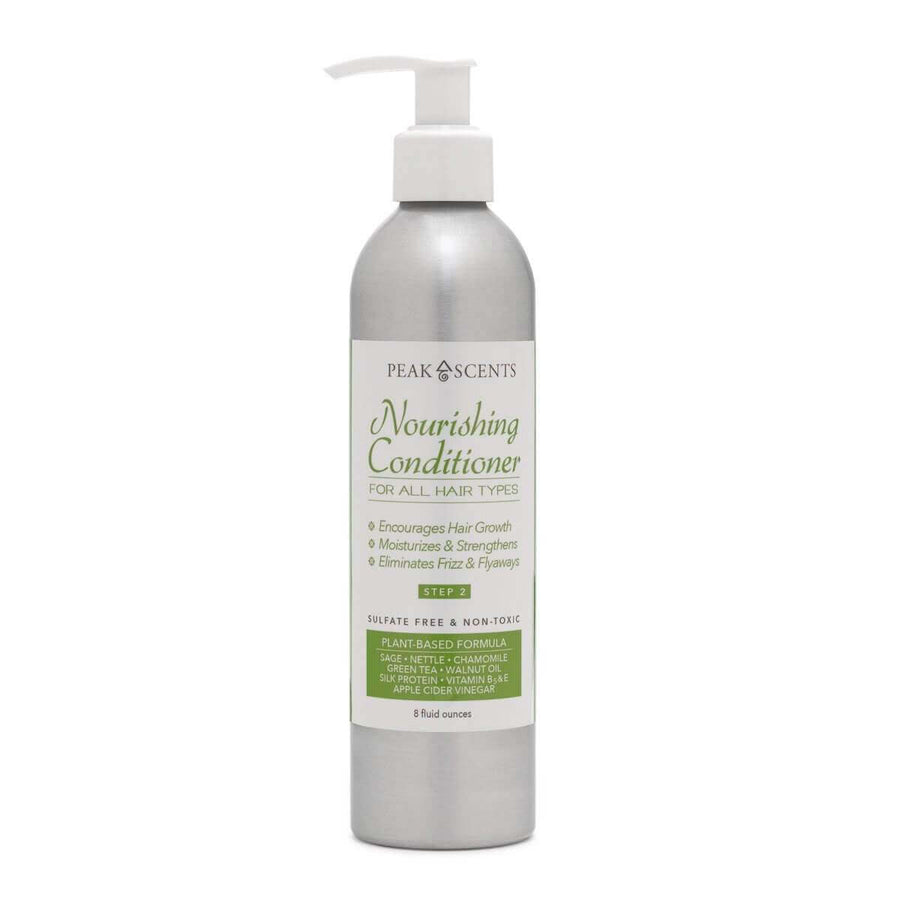 An 8 oz. metal bottle of Peak Scents Nourishing Conditioner with a pump top is seen against a white background