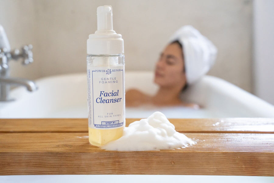 A woman is taking a relaxing bath, and the Power Repair facial cleanser is in the forefront.