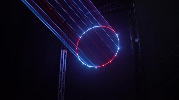 Laser Circle in Red and White with solid hot beams in Kvant Laser UK Demo Studio