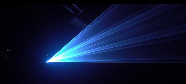 White and Blue Backdrop of Laser Effect in a dark Kvant Demo Studio