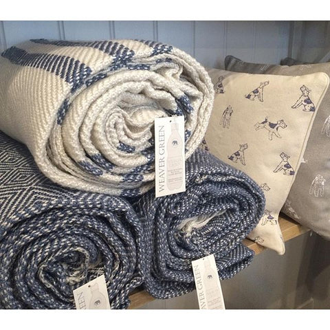 These stripe and geometric design throws are made from 100% recycled bottles! Weaver green Hare & wilde
