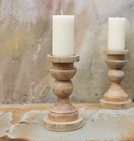 Beautiful handmade turned mango wood candle holders new in Hare & Wilde