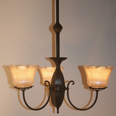 Antique Circa 1910 3 Light Converted Gas Light with Decorative Scroll Arms and Antique Holophane Shades.