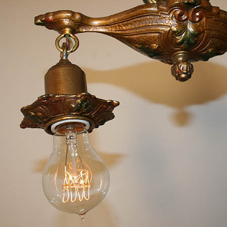 Antique Circa 1925, Two Light, Cast Iron Pan Fixture with Acanthus Details, Original Polychrome Finish, and fitted with Edison Style Lightbulbs.