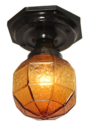Antique Circa 1920, Single Light Eight Sided Arts and Crafts Exterior Flush Mount with an Antique Amber Enclosed Shade.