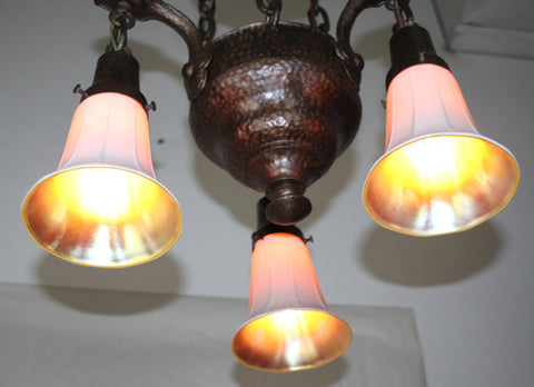 Antique Circa 1910,  Three Light Cast Hammered Arts and Crafts Chain Suspended Fixture with Art Glass Shades.