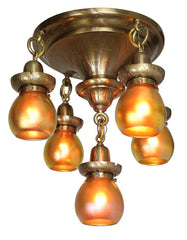 Incredible Antique Circa 1910, Five Light Flush Mount Fixture with a Repoussed Pattern and Stunning Signed Art Glass Shades.