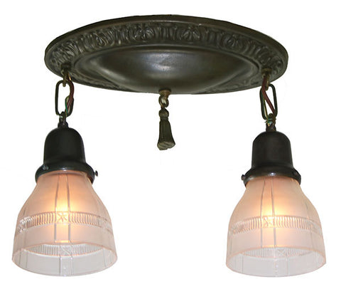 Antique Circa 1910 Two Light Embossed Oval Flush Mount Fixture with Antique Cut Shades.