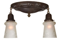 Antique Circa 1915 Two Light Flush Mount Fixture with an Embossed Leaf Border and Antique Shades.