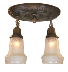 Antique Circa 1915 Two Light Embossed Acanthus Oval Flush Mount with Antique Elongated Cut Glass Shades.