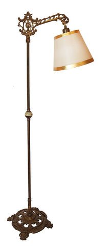 Antique Circa 1920, Single Light Cast Openwork Bridge Arm Floor Lamp with Four Footed Paw Base.