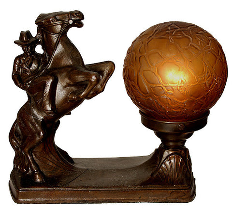 "Antique Circa 1930, Single Light, Art Deco ""Cowboy"" Table Lamp with an Antique Amber Brain Shade."