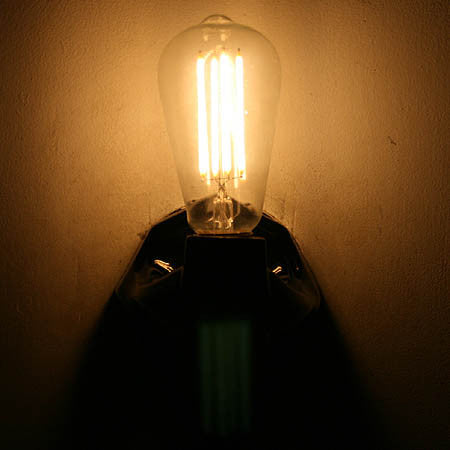 Antique Circa 1930, Single Light, Black Porcelain Diamond Back Wall Sconce With Decorative Edison Bulb.