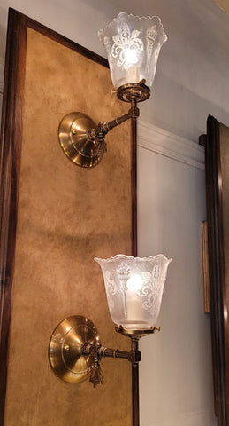 $850 PAIR - Antique Circa 1890 Converted Gas Stationary Wall Sconces with Antique Fleurs de Lis and Torch Glass Shades.