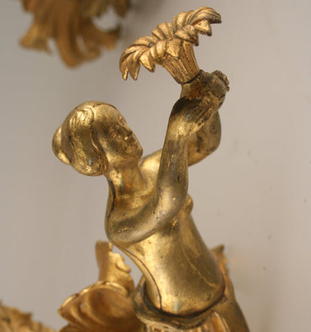figural gas wall sconce
