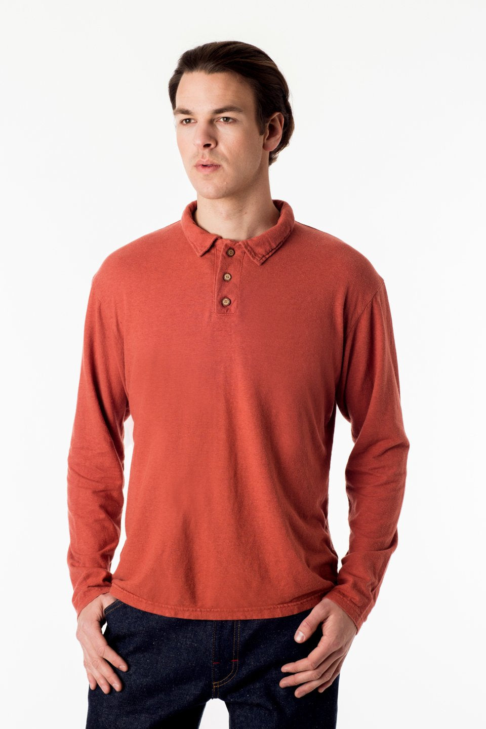 mens polo long sleeve shirt with three button closure at the neck, short collar and long sleeves in a light orange