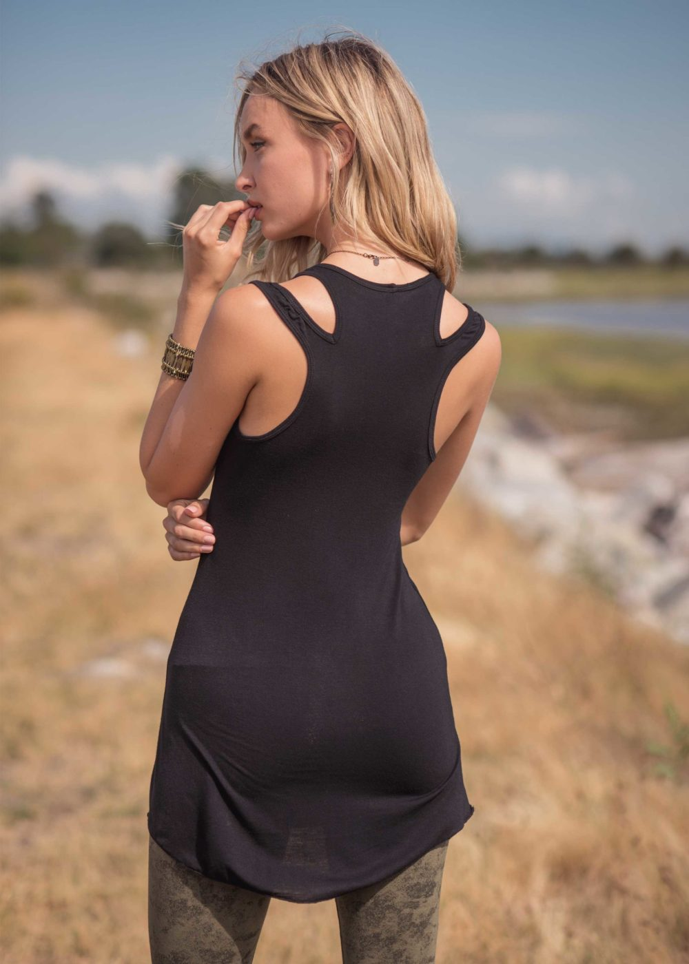 Back view of lyocell black long tank with back shoulder cut outs.