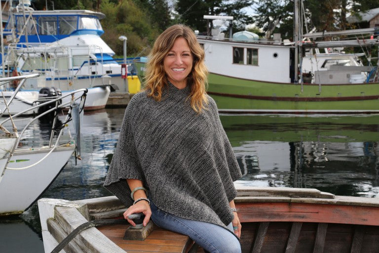 Knit wool poncho with a high neckline in grey