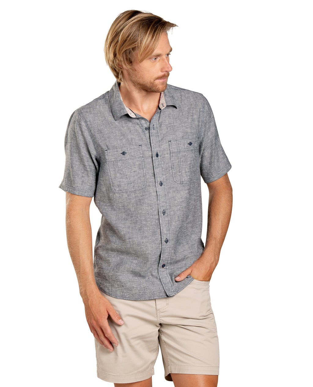 Grey print shirt with collar neck and two pockets at the front.