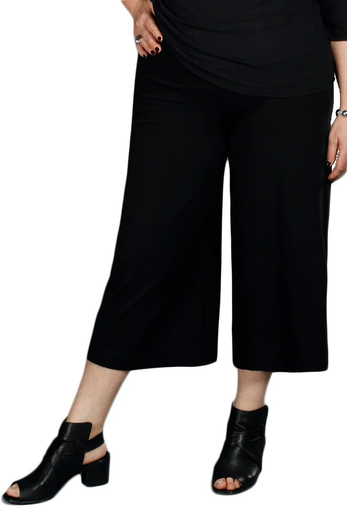 A wide leg capri pant with wide snug waist band and flowing legs stopping mid calf in black