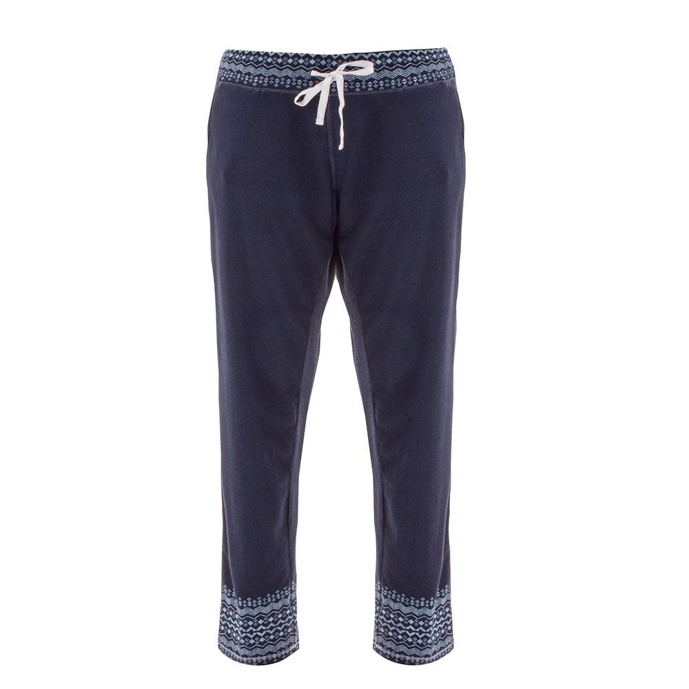 jersey pajama pants in a dark blue with snow flakes on the waist and bottoms of the pant legs