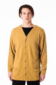 mens button front cardigan with long sleeves and a 'V' neck line and two horizontal front pockets at the waist in a light yellow