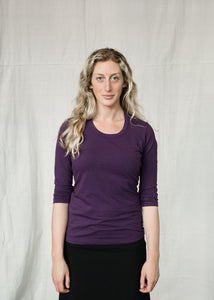 three quarter sleeve hemp and organic cotton shirt with a scoop neckline, three quarter sleeves and a fitted body in a neutral purple
