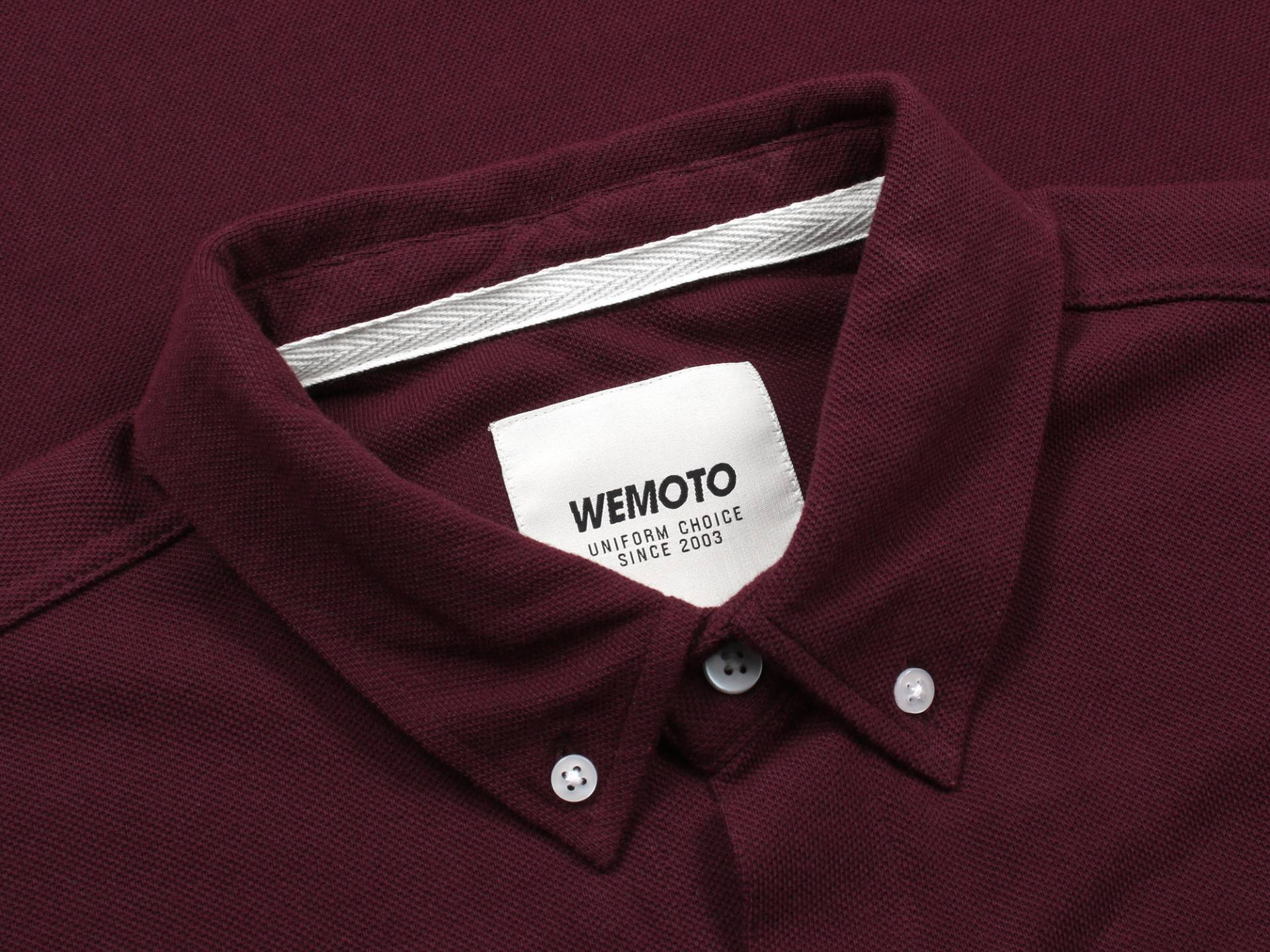 Soft cotton collar shows woven WEMOTO label within and button details aligning collar edges