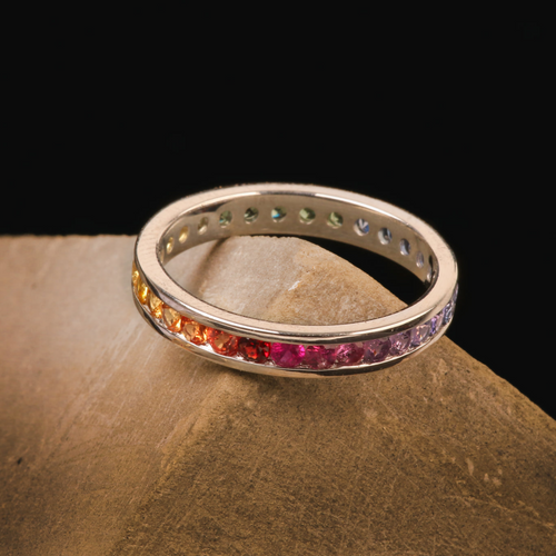 Kaleidoscope Rainbow Sapphire Channel Set Gold Eternity Ring - Brilliant Cut